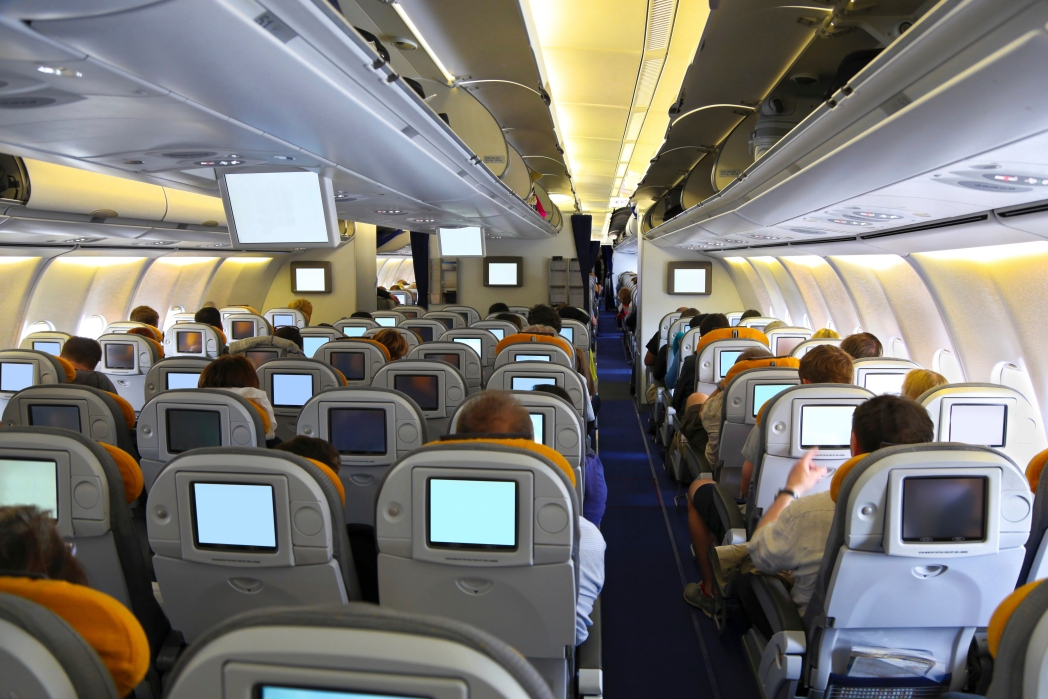 Interior of economy cabin with entertainment system