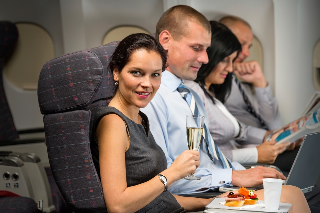 People enjoying a meal on a plane